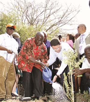 Taleb Rifai and Kenneth Kaunda - Tree Planing at IIPT Peace Park dedication