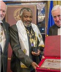 Patrick Kalifungwa receiving award