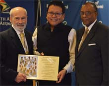 Mr. Armstrong Changsan receiving IIPT Plaque from Lou D'Amore and Timothy Marshall