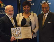 Ms. Nandi Mandela receiving IIPT Plaque from Lou D'Amore and Timothy Marshall